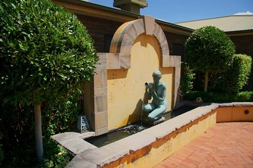 Water feature with sculpture