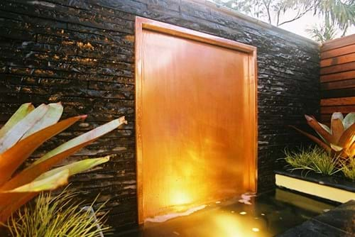 Copper water wall with splitstone surround
