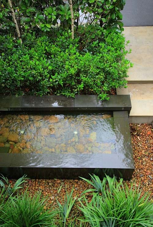 Spillover water feature with bluestone